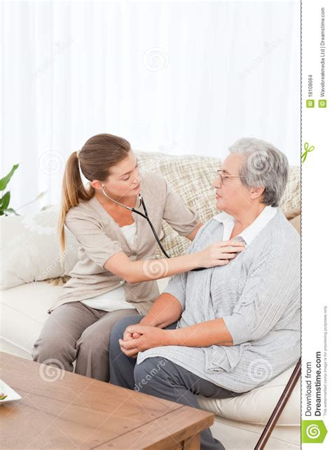 What Can A Patient Take To In House Detox by Taking Pulse Of Senior Patient Patient In Bed At