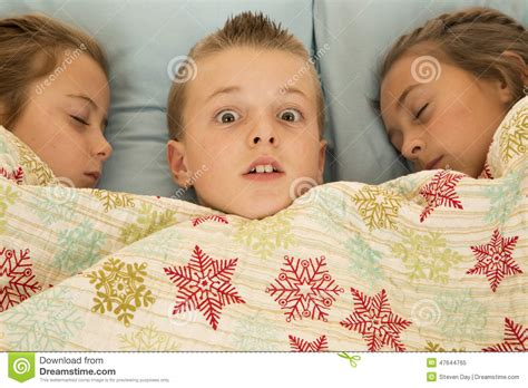 bed and boy expression on boys between two cousins in bed