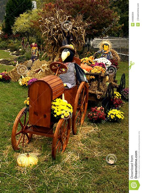 scarecrow decorations fall scarecrow driving tractor fall decorations stock photo