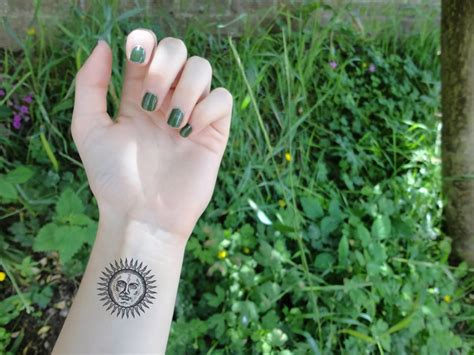 small sun tattoo small sun on left wrist