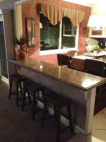 half table against wall turn that half wall into a breakfast bar additional