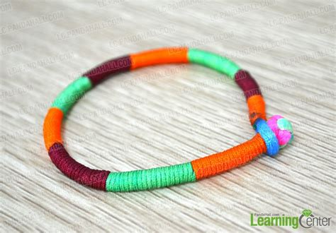 how to make string jewelry how do you make a wrap bracelet with 3 colored strings