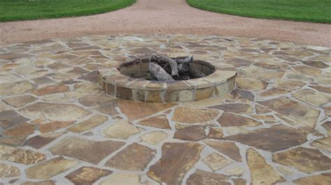 outdoor flagstone pit and sitting area that was