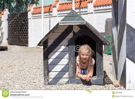girl dog house girl in dog house royalty free stock photos image 29606698