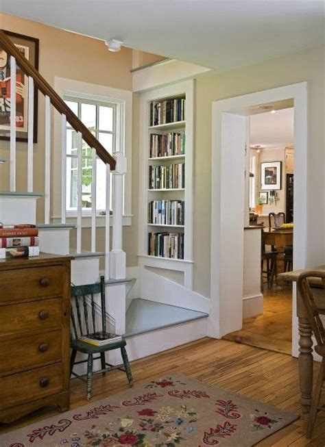 built in bookshelves stairs country living house tour its overflowing