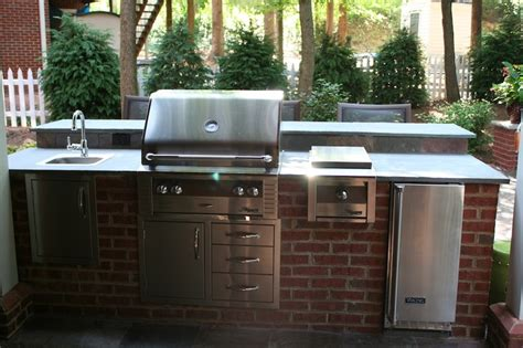 red brick outdoor kitchen island with raised seating bar outdoor kitchens pinterest
