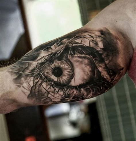 arm realistic eye tattoo by domantas parvainis