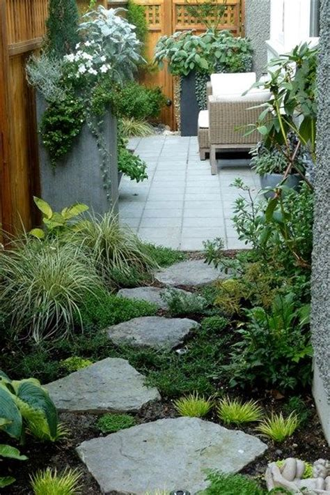 the zigzag path connecting the back garden to the side garden is accented by large planters that