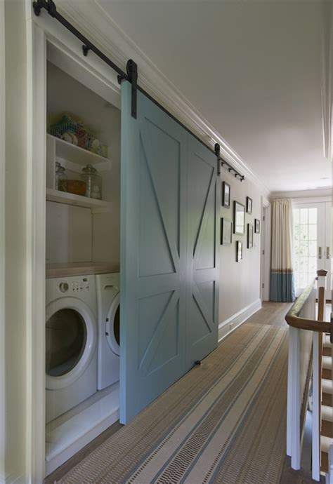 behind bedroom door laundry room hidden behind blue barn door ikea decora
