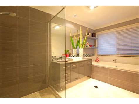 bathroom tile ideas australia modern bathroom design with corner bath using tiles bathroom photo 464609