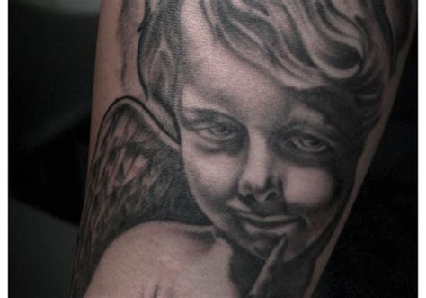 tattoo angel in hand 30 awesome baby angel tattoos creativefan