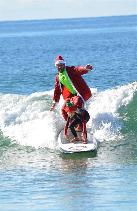 santa on surfboard surfing santa competition surfboard auction benefit surfers healing point times