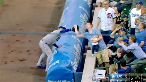 cubs newborn fan club dad makes amazing one handed catch while holding his