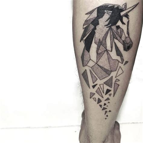 black and white geometric unicorn tattoo on shin tattoos pm
