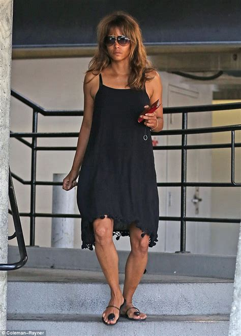 Halle Berry Gets On Knees For A by Halle Berry Looks Cheerful In Black Spaghetti Dress