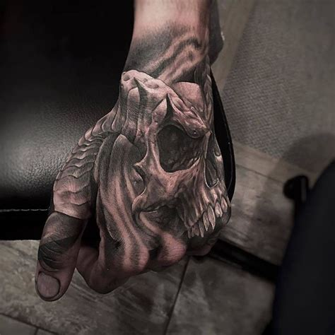 evil tattoo on hand skeleton hand tattoo on instagram