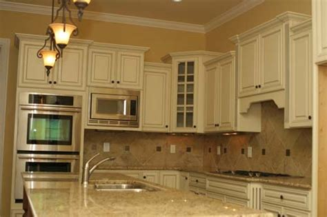 white kitchen cabinets with chocolate glaze white chocolate glazed kitchen cabinets chocolate glaze