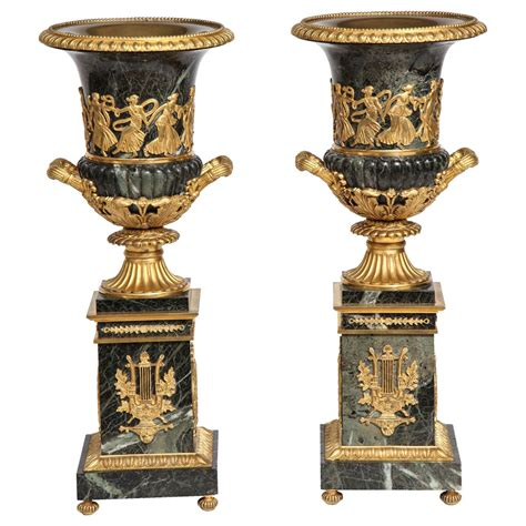 an antique urn with more elaborate designs and pair of antique neoclassical verde antico marble and ormolu mounted urns at 1stdibs