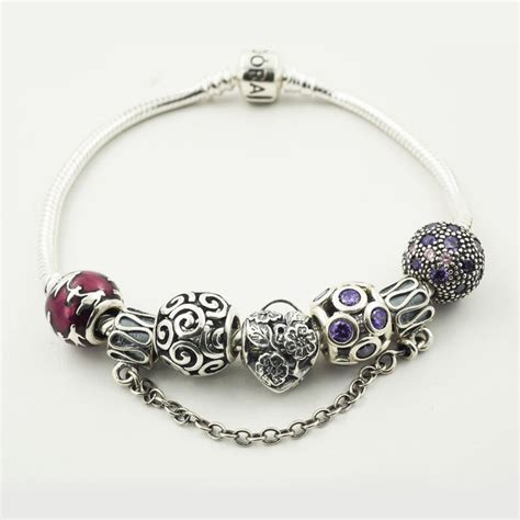 pandora silver charm bracelet with 6 assorted charms ale