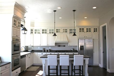 hide soffit above kitchen cabinets by adding crown molding amy s casablanca kitchen soffit transformation