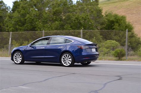 tesla model 3 refined blue tesla model 3 spotted once again near tesla hq
