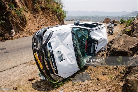 indian car on road content overturned car on mountain road in kashmir the