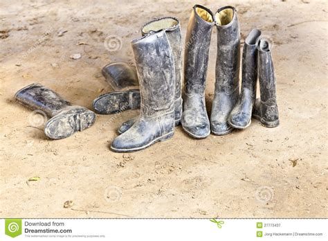 dirty riding boots dirty riding boots standing at muddy ground royalty free