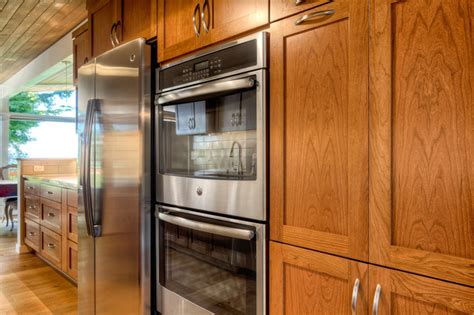 stainless steel appliances featuring white kitchen galley kitchen featuring stainless steel appliances