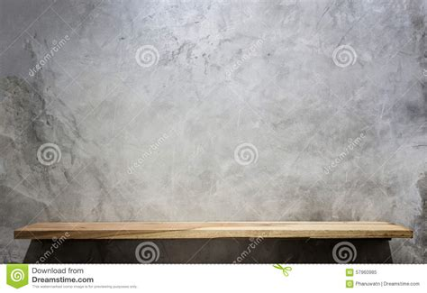 empty top wooden shelves  stone wall background stock