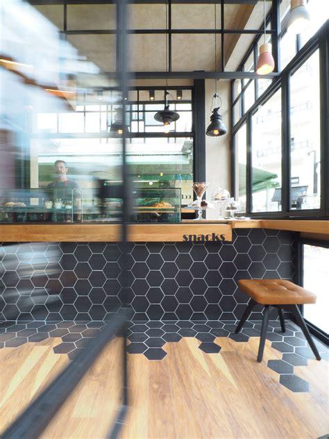 Chevron Bathroom Ideas hexagon tiles transition into wood flooring inside this