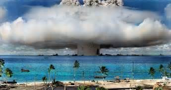 colorized photo of nuclear bomb test at atoll
