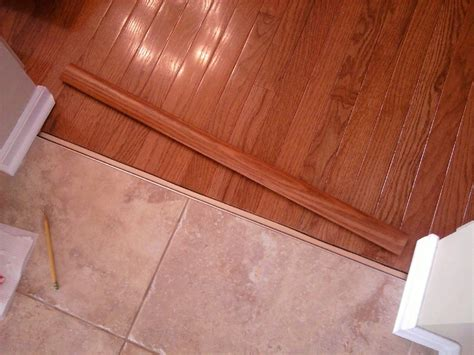 tile and wood floor transition door transition