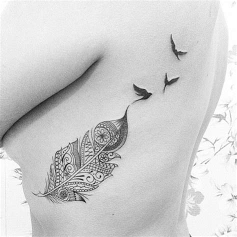 cute feather tattoos 30 cutest feather tattoos to dazzle you feather