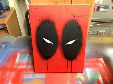 how to spray paint on canvas deadpool stencil and spray paint on canvas