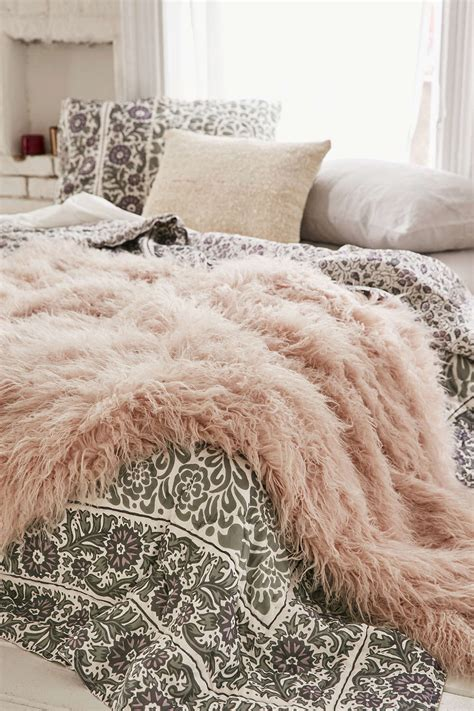 how to decorate with rugs 10 ways to decorate with a sheepskin rug