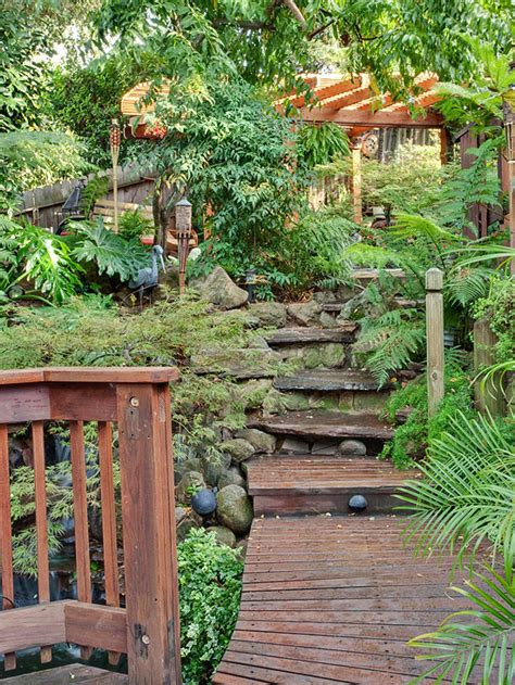 how to create a tropical backyard create a tropical retreat in your backyard
