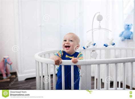 Baby Standing In Crib by Baby Boy Standing In Bed Stock Photo Image 73608149