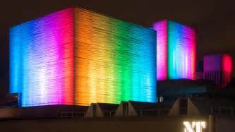 the national theatre lit up in rainbow colours