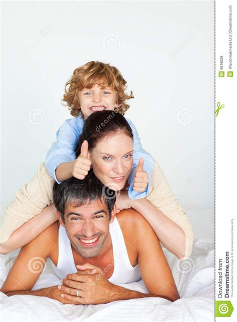 fun in bed family having fun in bed with thumbs up royalty free stock