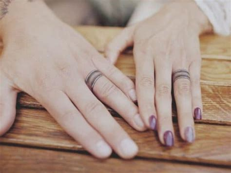 unique wedding ring tattoos     stand
