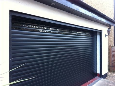 Changing Garage Door by Changing A Wooden Garage Door To A Roller Garage Door
