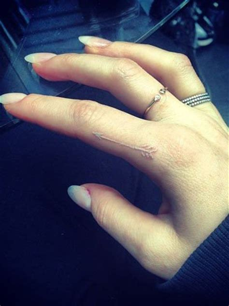 white finger tattoo ellie goulding s small white arrow on index finger
