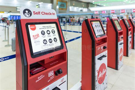 airasia check in time air asia self check in service counter editorial