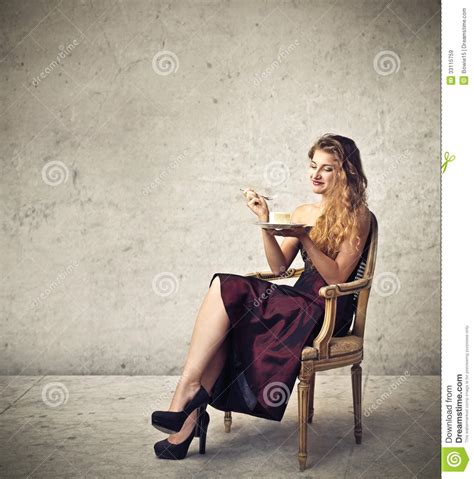 Sits In Chair To Eat by Royalty Free Stock Images Image