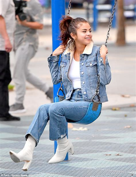hair time again here s looking at shoes kid selena gomez is all smiles as she grabs a juice with a pal