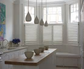Here are some wooden cafe style shutters below stained glass windows