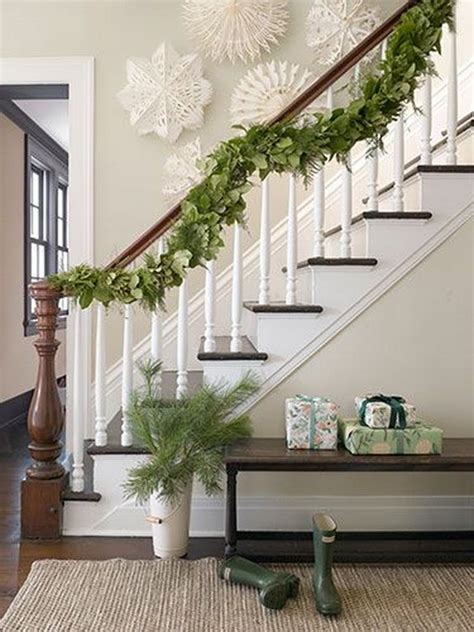 step into the christmas spirit with a garland draped