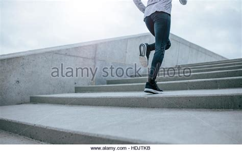 climbing stairs after c section woman running up stairs stock photos woman running up