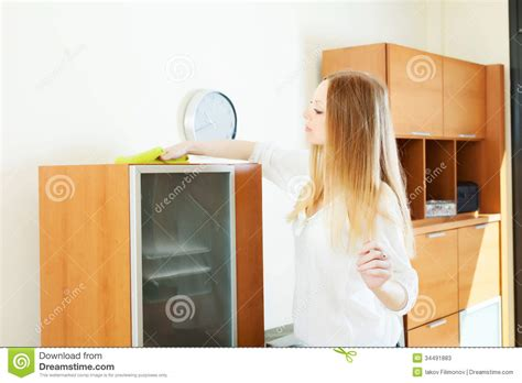 haired cleaning furniture stock photos