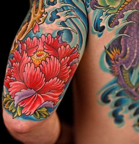 cool red japanese peony flower in waves tattoo on upper